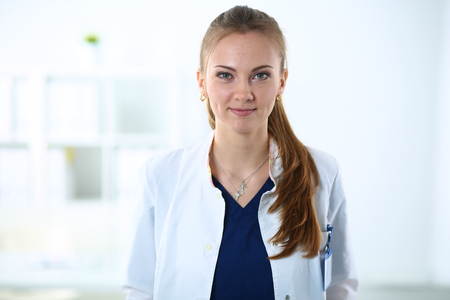 medical person: Portrait of woman doctor standing