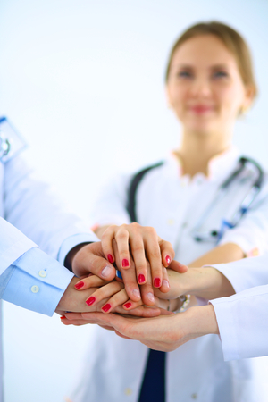 big woman: Doctors and nurses in a medical team stacking hands