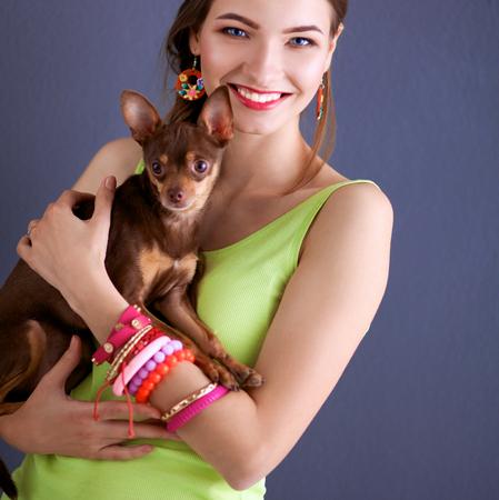animal image: Girl with a dog on grey background.