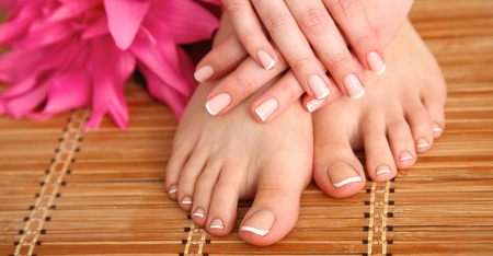 pedicure: Care for beautiful woman legs with flower .