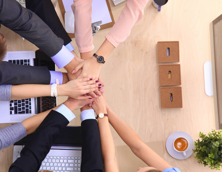 teamwork hands: Business team with hands together - teamwork concepts . Stock Photo