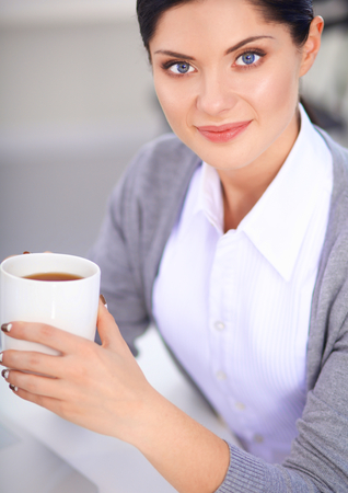 gleeful: Attractive businesswoman sitting  in the office