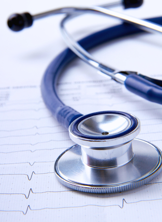 Stethoscope on electrocardiogram .