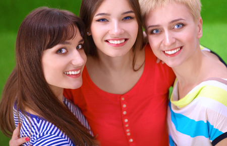 three persons only: Portrait of three young women, standing together . Stock Photo