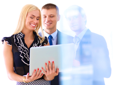staff team: Business woman standing with her staff in background at modern office . Stock Photo