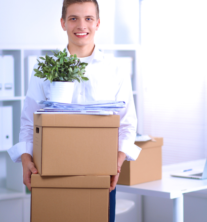 moving box: portrait of a person with moving box and other stuff Stock Photo