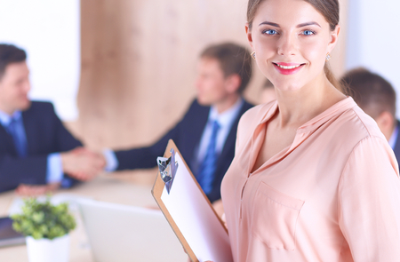 young adults: Business people sitting and discussing at business meeting Stock Photo