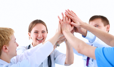 Doctors and nurses in a medical team stacking hands  . Stock Photo