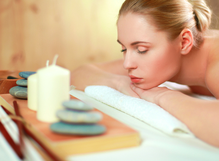 Young woman getting spa massage, lying on spa salon Stock Photo