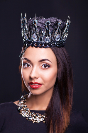 torn stockings: Portrait of woman in black crown Stock Photo