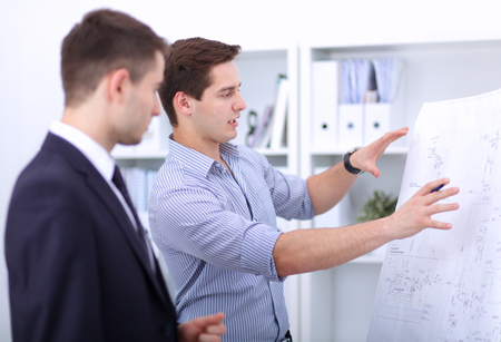 paper people: Business people discussing at business meeting, in office. Stock Photo