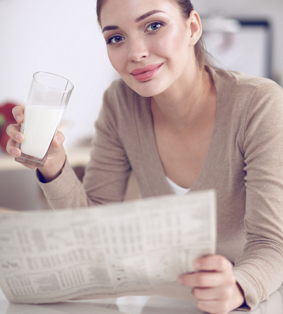 Happy young woman having healthy breakfast in kitchen, isolated