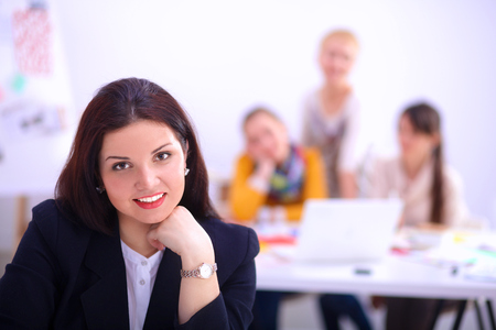 glee: Attractive businesswoman sitting  in the office, at the deskwith cup of coffee. Stock Photo