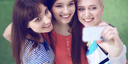 3 persons only: Portrait of three young women, standing together.