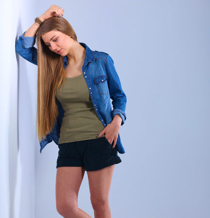 full lenght: Full lenght a young woman standing near wall . Stock Photo