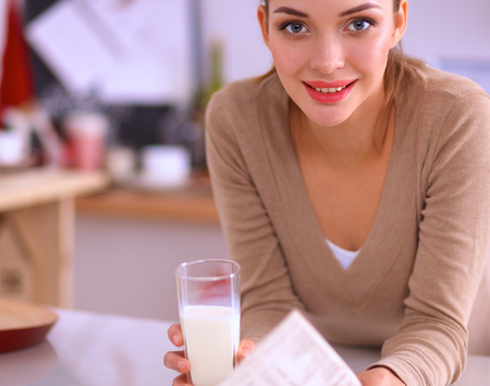 house robes: ?oung woman having healthy breakfast in kitchen Stock Photo