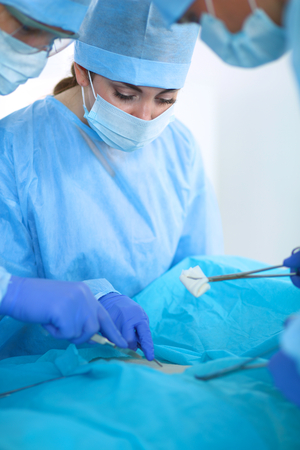 anesthetist: Young surgery team in the operating room . Stock Photo