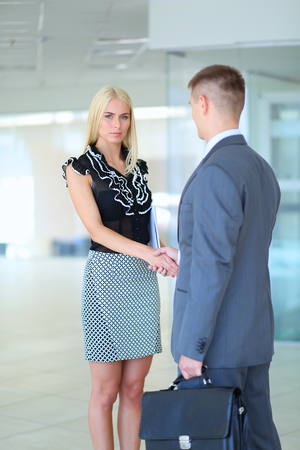 unrecognizable: Businesswoman shaking hands in office .