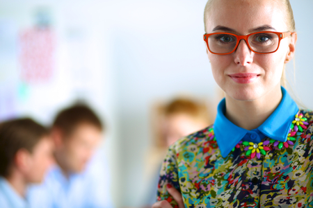 designer working: Young attractive female fashion designer working at office desk . Stock Photo