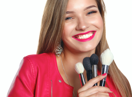 Young beautiful woman holds in hand brush for makeup . Stok Fotoğraf