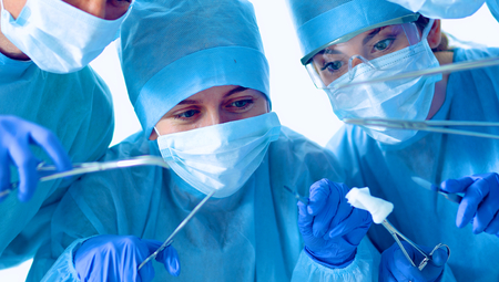 Below view of surgeons holding medical instruments in hands . Stock Photo