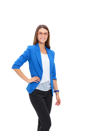 businesswoman suit: Portrait of a confident young woman standing isolated on white background Stock Photo