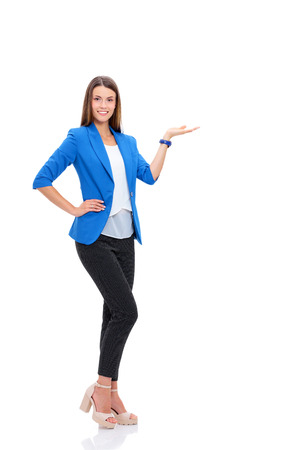 Portrait of young business woman pointing