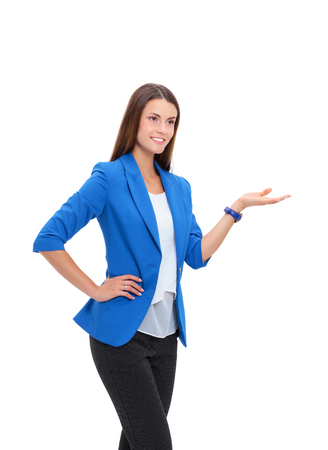 businesswoman suit: Portrait of young business woman pointing