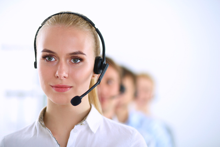 Attractive positive young businesspeople and colleagues in a call center office. Stock Photo