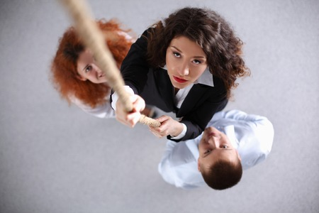 ascending: Image of businesspeople ascending up the rope , standing Stock Photo