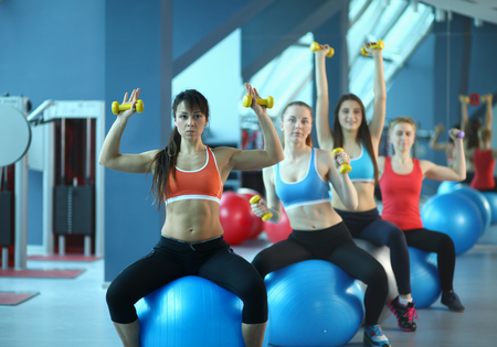Group of people in a Pilates class at the gym . Stock Photo