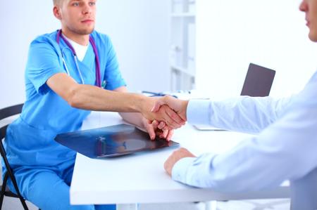 handshaking: Doctor and patient handshaking. Hands close-up Stock Photo