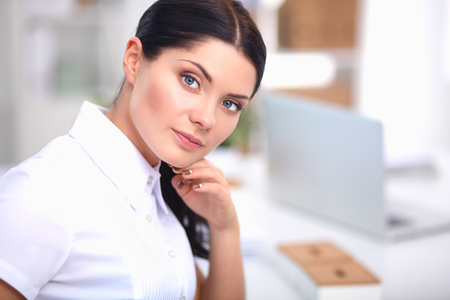 principal: Attractive businesswoman sitting in the office, isolated
