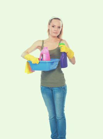 charlady: Cheerful woman is cleaning something with wisp and spray attentively