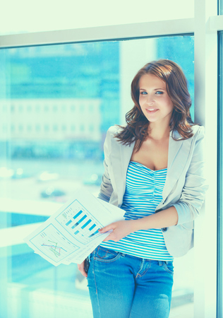 only 1 woman: Portrait of young busineswoman standing in office lobby. Stock Photo