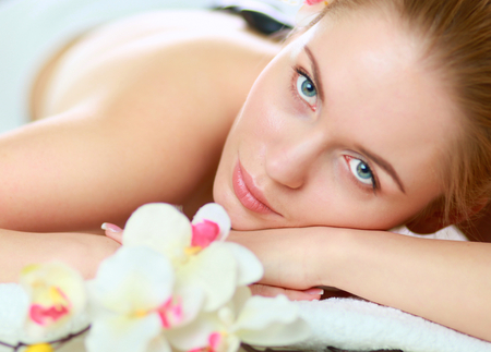 Young woman getting spa massage, lying on spa salon Stock Photo