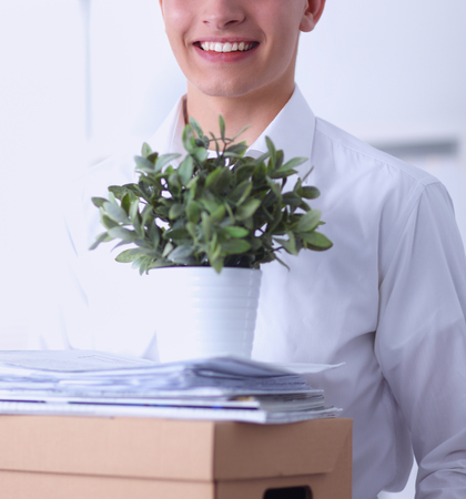 portrait of a person with moving box and other stuff Stock Photo