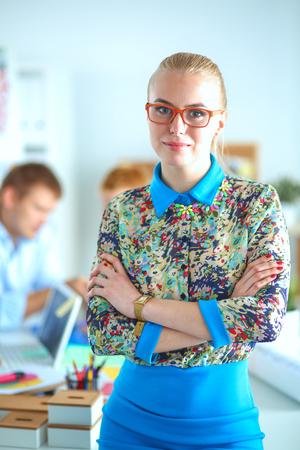 Portrait of attractive female designer in office.