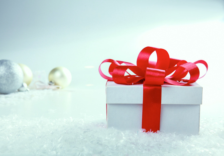 goodie: White gift box with red ribbon and bow Stock Photo
