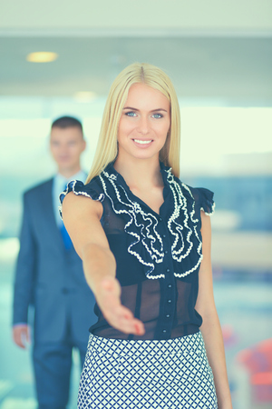 Young businesswoman shaking hands in office Stock Photo