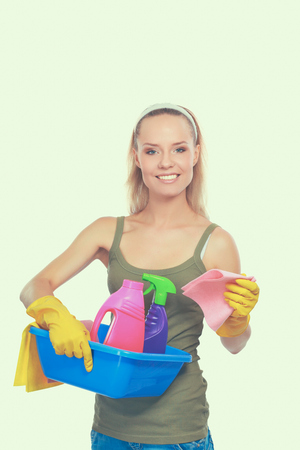 Cheerful woman is cleaning something with wisp and spray attentively. Standard-Bild