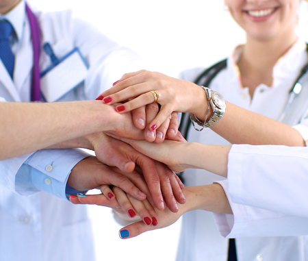 medical doctors: Doctors and nurses in a medical team stacking hands