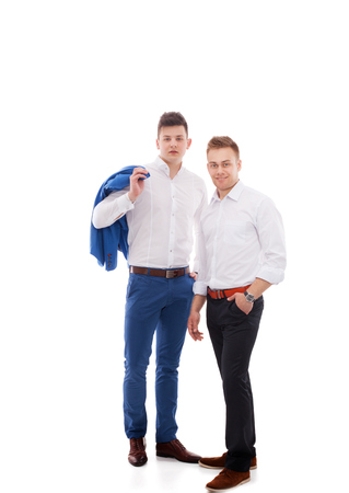 Young two men standing , isolated on white background