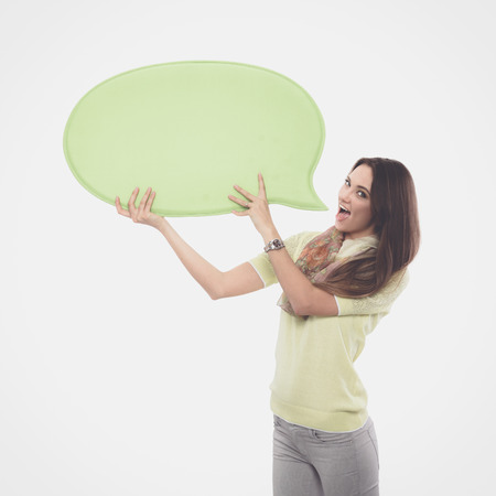 contact info: Portrait of a casual young woman holding blank card - over white background.