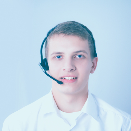 handsfree telephone: Customer support operator with a headset on white background