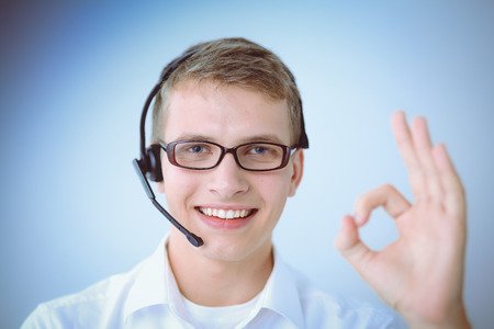 handsfree telephone: Customer service agent showing ok, isolated on white background Stock Photo