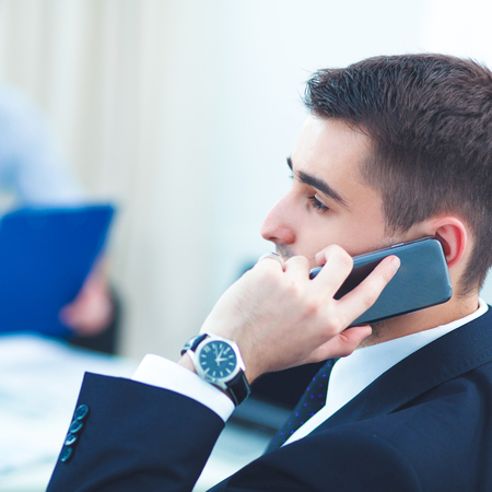 telephone interview: Business people talking on phone at office