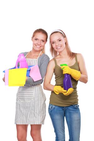 charlady: Two women is cleaning something with wisp and spray attentively. Stock Photo