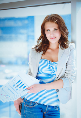Portrait of young busineswoman standing in office lobby Stock Photo