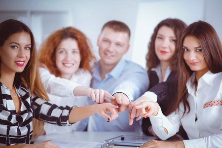 associate: Business people group team point finger at you Stock Photo